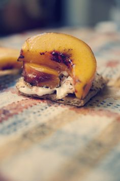 S'meaches (s'mores+peaches), click for video! 1 peach, sliced and halved, 6-8 marshmallows, 1/2c brown sugar, 1/2tsp cayenne pepper, graham crackers. Mix cayenne and sugar, and toss the peaches in it. Put a bottom half of a peach slice on a stick, add marshmallow, then the other half of peach. Toast over a medium-low flame until caramelized and browned. Enjoy!