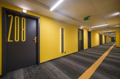 Stunning Complex Tobaco Hotel Building Design by EC-5: Innovative Rooms Facade In Tobaco Hotel With Yellow Wall, Grey Door And The Big Room ...