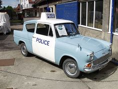 Ford Anglia car in pale blue paint, with white overpainted doors and roof. The roof also carries a Police lightbox sign and flashing blue light. Ford Motor Company, Vintage Bicycles, Vintage Motorcycles, Classic Chevy Trucks, Classic Cars, Heartbeat Tv Show, Detective, Pale Blue Paints, Ford Anglia
