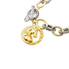 Beautiful two-toned silver and gold bracelet with gold horse charm.