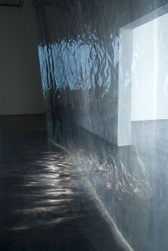 by Anna Veronica Janssens. [Image #3 of Week: Jan. 27th - 31st]. I really like the simplicity of this installation, the sheerness and reflections cast by the light create a monochromatic range of colors and the illusion of movement. It almost looks like rippling water at night.