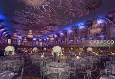 Photo: Carasco Photography Floral and Event Design: Kehoe Designs  Venue: Hilton Chicago  Purple lighting with white flowers and candles as centerpieces