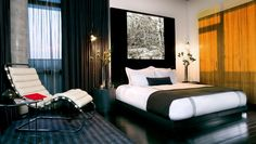 Thompson LES: Spacious King Deluxe Rooms have floor-to-ceiling windows and city views.
