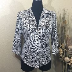 Zebra Print Top 💥20% OFF BUNDLE💥 Stunning zebra print top with 3/4 sleeves. Button up style is really sharp over a black or white tank. Like new condition.Chico's size 0. Chico's Tops