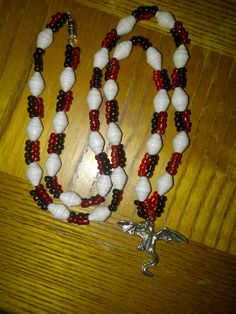 Dragon necklace with white paper beads
