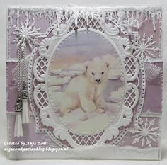 Handmade card by DT member Anja with Creatables Anja's Oval (LR0376), Tassel Trendy (LR0390), Snowy Icicles (LR0392) and Ice Crystals (LR0393) from Marianne Design