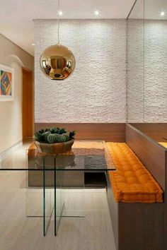 Bench-style dining room seating with a glass top table creates a modern dining nook in this home. Dining Nook, Dinning Table, Home Interior, Interior Decorating, Modern Interior, Sweet Home, Dinner Room, Small Dining, Room Decor