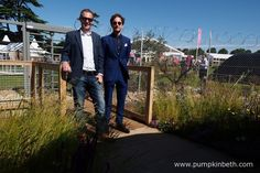 John Ward and Tom Massey, pictured entering the UNHCR: 'Border Control' Garden they designed to raise awareness of the plight of refugees, at the RHS Hampton Court Palace Flower Show 2016.