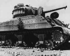 A wrecked M4 Sherman tank showing a shell hit on its outer wooden timbers Iwo Jima 15 March 1945.