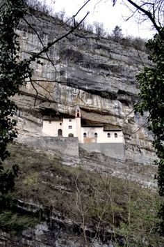 The Leno valley of the Trento province is home to the Hermitage of San Colombano.  One hundred and twenty meters up a cliff face, seemingly carved into the side of the deep valley, the Hermitage is in clear view. Built in 1391.