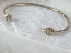this old sterling bracelet shows handcrafted beauty! The adjustable gap in the front allows an easy fit, with acorn/organic design in the front. This bracelet is for small wrists. Sterling Jewelry, Gemstone Jewelry, Sterling Silver, Bangles, Bracelets, Wholesale Jewelry, Acorn, Jewelry Watches, Organic