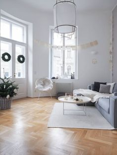 Name: Svenja Bruecker Location: Vienna, Austria Size: 1300 square feet Years lived in: Renting 6 months Svenja is an interior design blogger and her boyfriend Jonas is a professional poker player, and they share a 1300 square foot airy apartment in a big old building in the heart of Vienna. It's also the kind of all-white, Scandinavian-inspired dream holiday home that's just perfect for kicking off this holiday season!