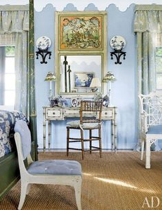 Painted furniture and a blue, white, and green palette freshen the master bedroom. Brackets from John Rosselli hang above a Louis J. Solomon faux-bamboo desk with custom-painted decoration by Christian; the curtain fabric is by Brunschwig & Fils, a Clarence House stripe covers the slipper chair, and the sea-grass carpet is by Stark.