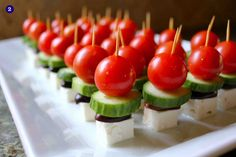 Greek salad on a stick! Follow the link for loads of different foods on a stick. Perfect for a party.