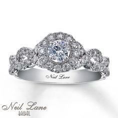 If I could have my dream ring this is it!! Absolutely gorgeous!  Its a Neil Lane design sold at Kay jewelers.