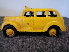 Antique Cast Iron Yellow TAXI Toy Car Sedan Reproduction SOLD!! Was available at Gadgets and Gold in Gainesville, FL!