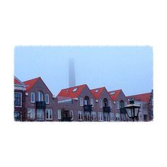 A #foggy morning in #Leiden with the #tower of the electric plant #delichtfabriek in the houses' background.