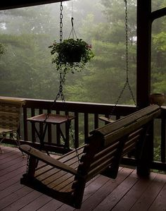 Imagine waking up in a cozy cabin in the mountains and walking out into this porch with hot tea in hand, inhaling the fresh smell of an early morning rain :) Peaceful. ~ yes, i want a porch like this and a swing. I always love sitting on the porch. Outdoor Spaces, Outdoor Living, Outdoor Decor, Outdoor Kitchens, Cozy Room, Cabins In The Woods, Cottage In The Woods, House In The Woods, Rainy Days