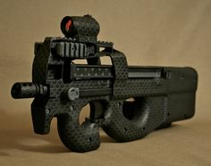 FNH PS90 short barreled. Custom Midnight Snakeskin duracoat paint job. U.S. Secret Service as well as many SWAT teams around the world have the fully automatic P90 in service. This firearm is regarded as one of the best in the world.