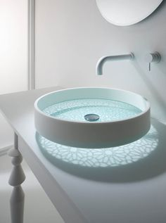 MOTIF GLASS BASIN looks super with it's see through glass bottom and the effect of the light on the counter. Omvivo has some great modern fixtures. Take a look around their site. You may find something you'll Love!