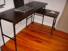 DIY customized industrial pipe workspace with rollout side table.  Maybe this one instead of the other.