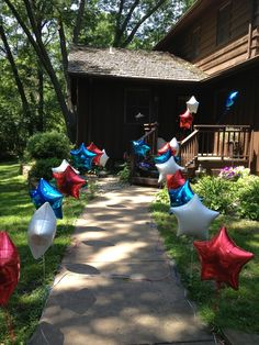 Deployment homecoming or boot camp return. Line walkway with balloons held down with golf tees.