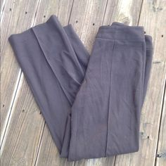 Brown trouser pants No flaws that I can see. Brown pleated trouser pants. 31.5 inch inseam. Thanks for looking. Rafaella Pants Trousers