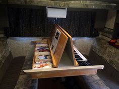 Keyboard and art table inside a dinette table in a truck camper: http://www.truckcampermagazine.com/camper-mods/contests/april-mod-contest-mega-mods/