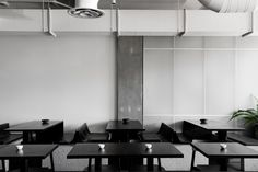 Concrete and terrazzo furniture feature in Ritz&Ghougassian's minimal Penta cafe
