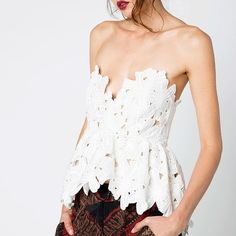 Stone Cold Fox Lace Texas Tube Top The Stone Cold Fox Texas Tube Top in White is a statement making bodice. This piece features an embroidered lace overlay with a slightly cropped hem that flares and a back zipper.   Self: 100% polyester. Contrast: 95% linen, 5% spandex. Lining: 100% silk. Tag reads M/L, but this piece runs small and would suit a size S. Stone Cold Fox Tops Crop Tops