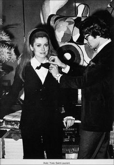 "Yves Saint Laurent with Catherine Deneuve in his ""Le Smoking"" tuxedo design."