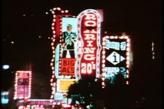 San Francisco, 1970s, North Beach by night, traffic, neon, tawdry district