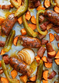 Tender sweet potatoes, crisp bell peppers, sweet onions, and spicy sausage are roasted together in this easy as can be meal that my family just can't ...