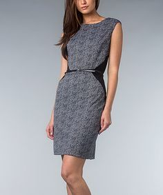 A haute herringbone print takes this posh frock from staple to standout. With its sleek belted waist and slimming solid black panels, this desk-to-dinner dress flaunts fiercely feminine fashion while maintaining a polished look.