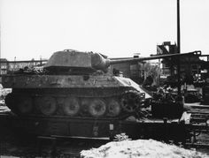 Panther with its turret knocked off center mounting, and a large penetration on its flank.