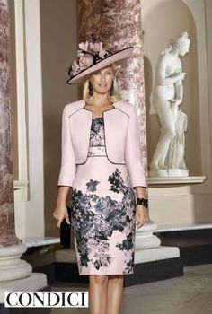 Condici 70818 mother of the bride dress and bolero is now in stock from the new 2016 Condici collection. A pink shift dress with cap sleeves and features a soft grey and black flower print all over. Dress zips up at the back. It's teamed with a plain pink bolero jacket piped with a black/grey trim. In-stock and available to buy in-store or by telephone mail order. More details http://www.fabfrocks.com/condici-70818.ir?cName=brands-condici #condici #motherofthebride #motherofthegroom #wedding