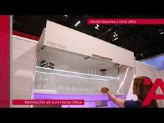"""Interzum 2015 : plus de vie au m2 !  >> La cuisine devient un bureau à domicile : un tiroir coulissant déplie une table cachée dans l'ilot central, le plan de travail s'élève via un élévateur électrique, un capteur de mouvement dans les plinthes permet l'ouverture """"mains libres"""" de tiroirs de rangement, un relevant Free fold favorise l'accès aux verres, un aspirateur intégré aux plinthes facilite les tâches ménagères, un chargeur de smartphone invisible qui fonctionne par simple contact..."""