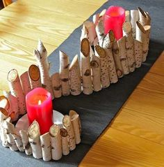 wood pieces and candles centerpiece idea