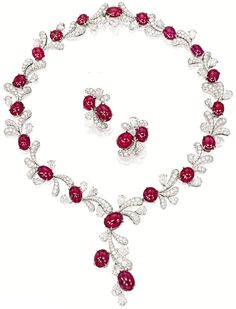 Ruby and diamond fireworks set by James W. Curren for Faidee. -The necklace contains 20 cabochon rubies totaling and cts of pear-shaped and brilliant cut diamonds. Via Diamonds in the Library. Ruby Necklace, Ruby Earrings, Ruby Jewelry, Diamond Jewelry, Jewelry Sets, Jewelry Accessories, Fine Jewelry, Jewelry Design, Diamond Choker