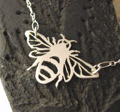 Apis mellifera  - Honey bee sterling silver necklace - nature lover, garden friend - saw pierced by hand, handmade with love. $72.00, via Etsy.
