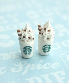 this earrings features a pair of mini Starbucks drinks sculpted from polymer clay. each measures about 1.5 cm tall and is securely attached to a nickel free silver tone posts. please include the desig