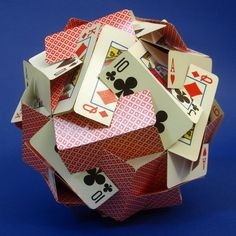 Two years ago, we looked at some constructions made from playing cards that are slotted and slid together. Here is a new one, by Zach Abel.