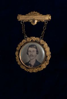 Civil War Virtual Museum | Major Guerrilla Warfare Actions | William C. Quantrill Reunion Badge