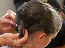 How Amish pin up their hair... the hairnet  gathered at the back