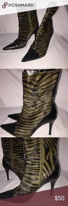 Enzo Angiolini Boots Boots are pony hair and leather they are in EUC with a blemish on the right heel. With great regret cleaning out the closet my lost may be your treasure. Enzo Angiolini Shoes Heeled Boots