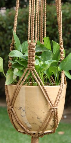 CROWNE ROYALE Macramé Plant Hanger Holder  6mm Braided Poly Fiber Cord - CINNAMON Four, Round, 1-inch (25mm) Wood Beads - NATURAL One 2-inch Welded Brass Ring  APPROXIMATE LENGTH (measured flat): Top of ring to base = 46 inches Base of pot to end of tassel = 13 inches Overall hanging length = 59 inches (will shorten slightly when hanging with pot)  Plant hanger is shown with an 8-inch pot (**NOT INCLUDED**). Finished length of hanger will vary with other pot sizes or shapes.  I create my…