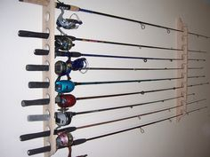 Solid Oak Fishing Pole Rack (Holds 10 Poles). $30.95, via Etsy.