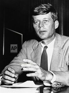 """Rep. John Kennedy, Sept. 5, 1952 in Washington urges at a Labor Dept. hearing that minimum wages on government contracts in the textile industry """"raised to a realistic level and continued on a national rather than a regional basis."""" The present minimum is 87 cents an hour."""