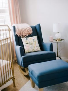 This navy rocking chair is so bold in the otherwise pastel nursery. We LOVE this look!