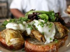 """Miami, Florida: Blue Collar : <p>Benedicts are a brunch staple on menus around the country, but few highlight a vegetable as the unifier between the egg and the bread. At <a adhocenable=""""false"""" href=""""/content/food/restaurants/fl/miami/b/blue-collar.html"""">Blue Collar</a> in Miami, locals line up for Chef de Cuisine Ervin Bryant's Artichoke Eggs Benedict, which he prepares using ciabatta as the base for sauteed Italian artichokes. Bryant reserves some of the canning liquid from the artichokes…"""